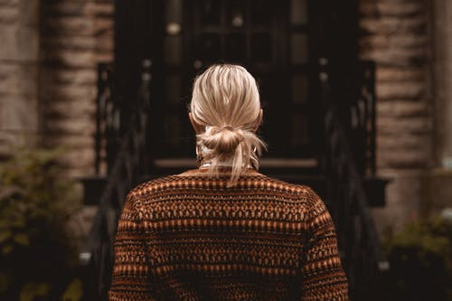 Woman in Brown Knit Sweater