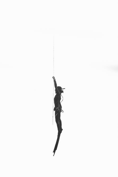 Diver silhouette against white background