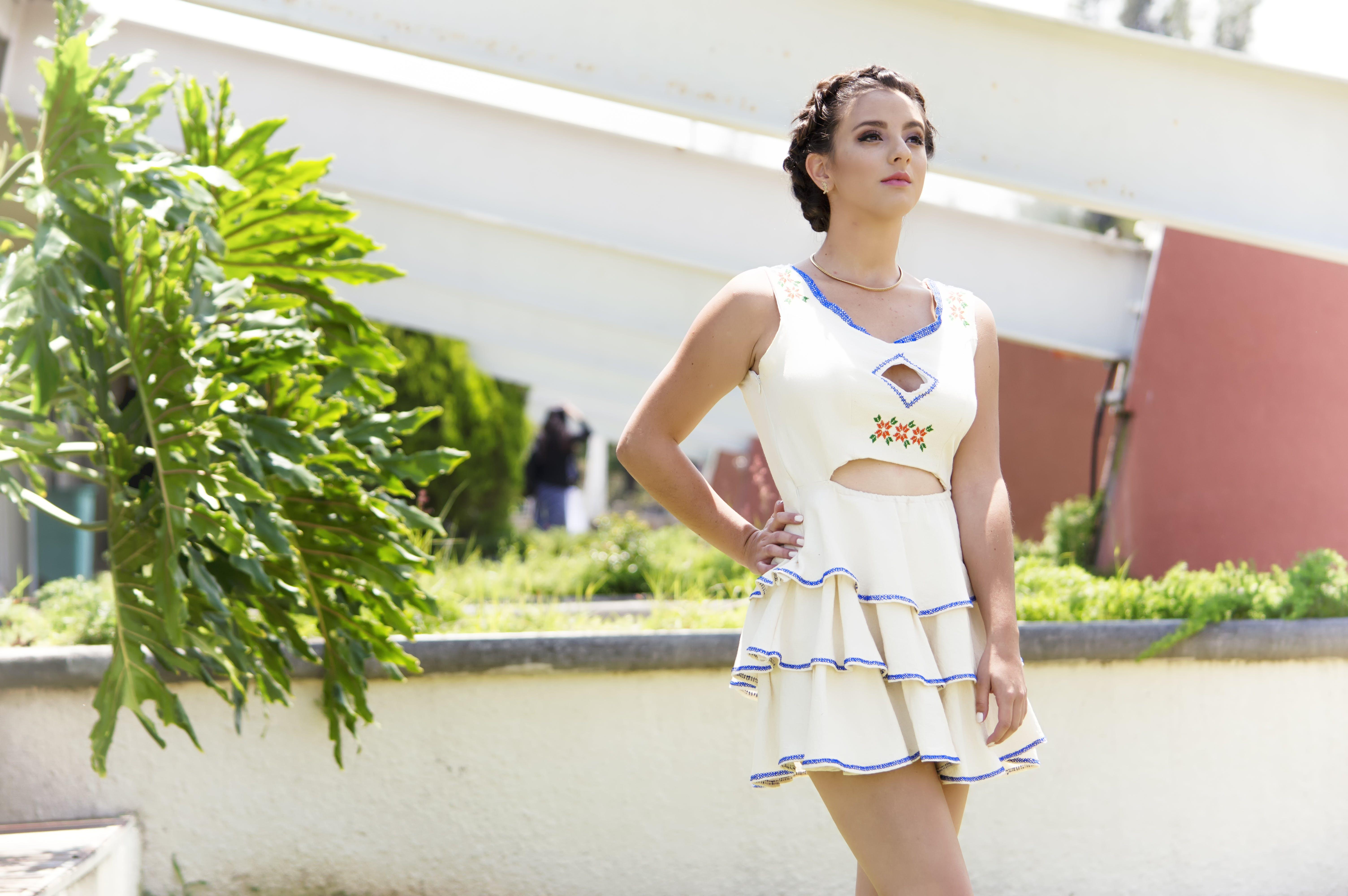 Woman Wearing White Scoop-neck Sleeveless Tier Dress