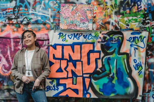 Woman Standing Near Graffiti Art