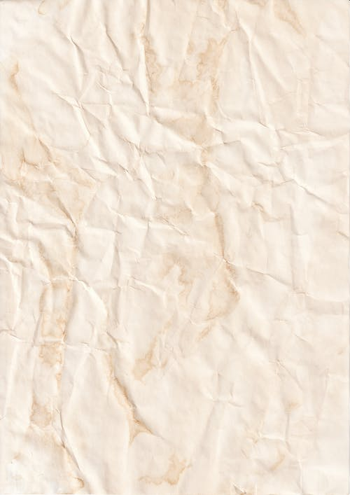 White Textile on Brown Wooden Table