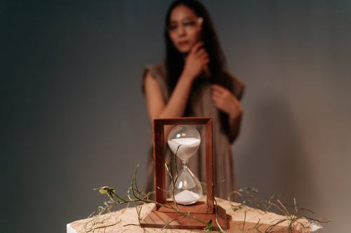 Hourglass on Brown Wooden Frame