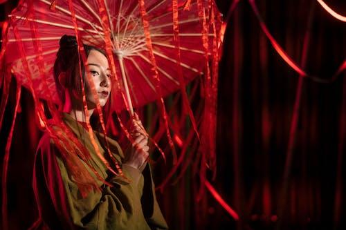 Woman in Brown Kimono Holding Red Umbrella