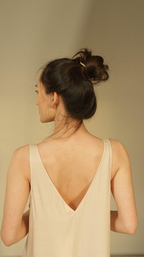 A Woman Wearing s Tank Top