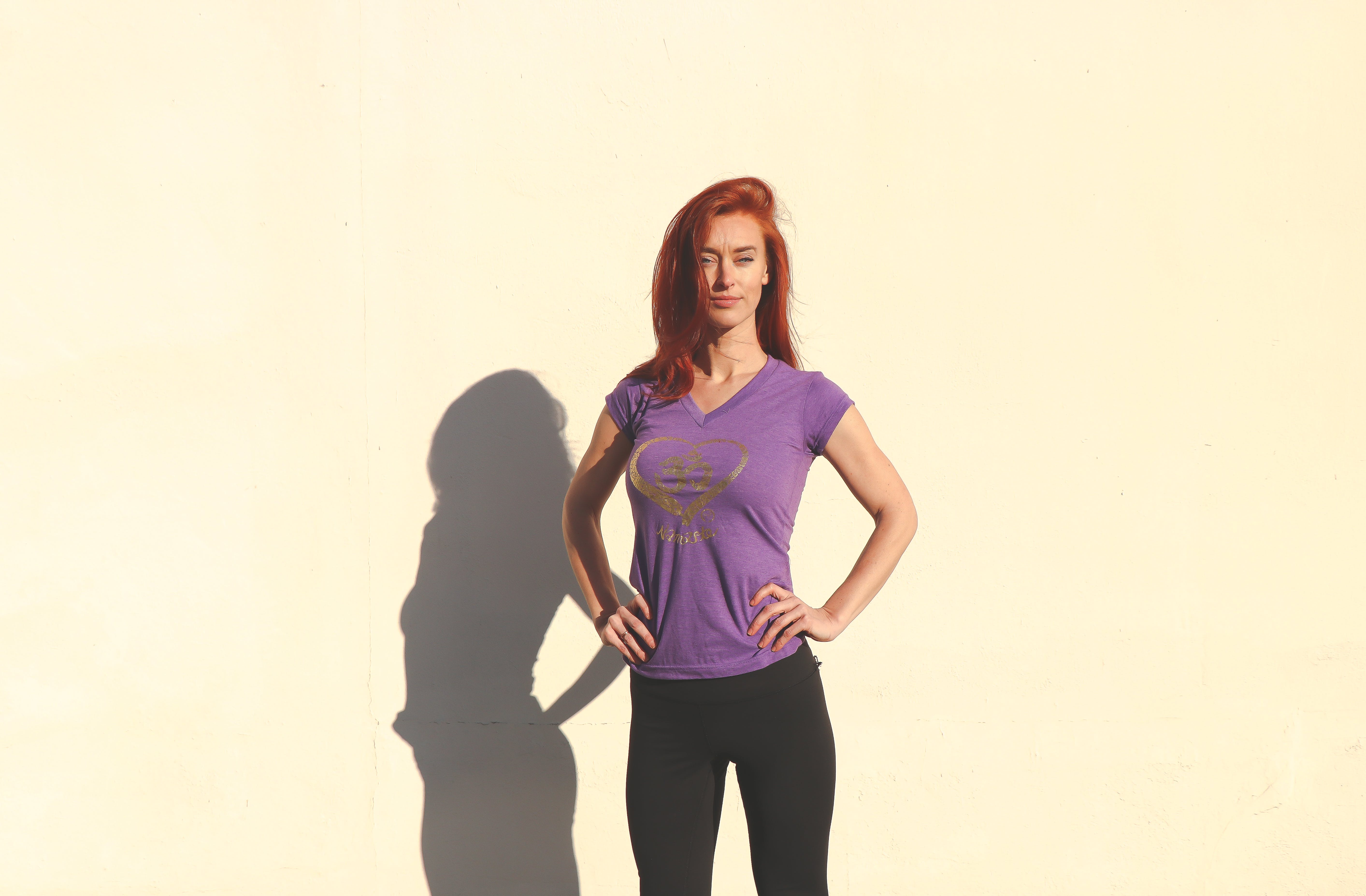 Woman Wearing Purple Shirt and Black Pants