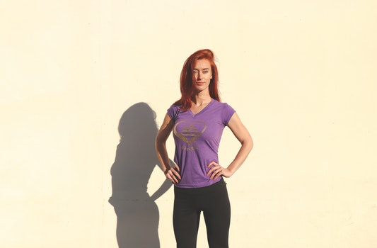 Woman Wearing Purple Shirt and Black Pants