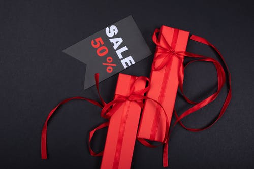 Red Gifts Beside a Sale Tag