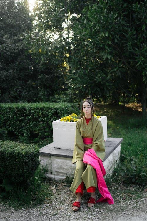 Woman Sitting On Gray Concrete Bench