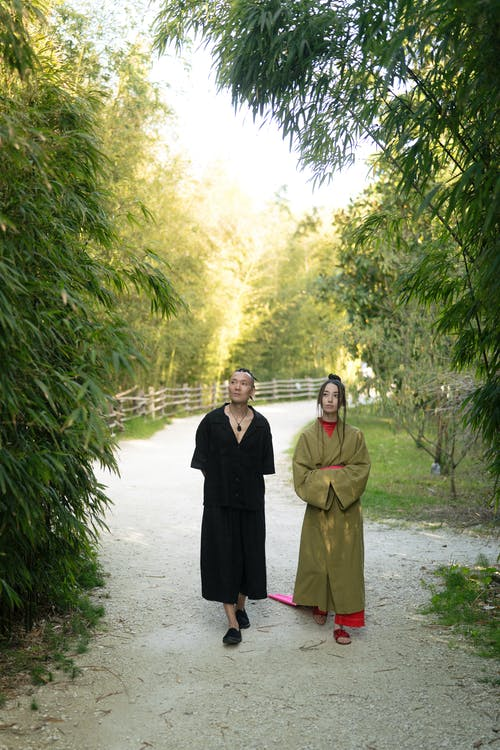 Man And Woman Walking In An Unpaved Road