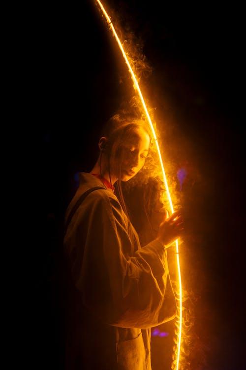 Woman Touching A Light Reflection