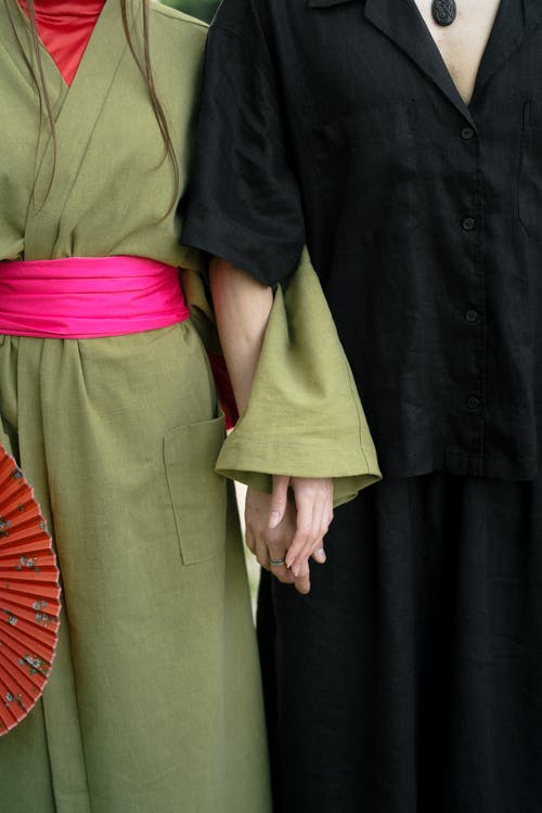 Crop Photo Of Man And Woman Holding Hands
