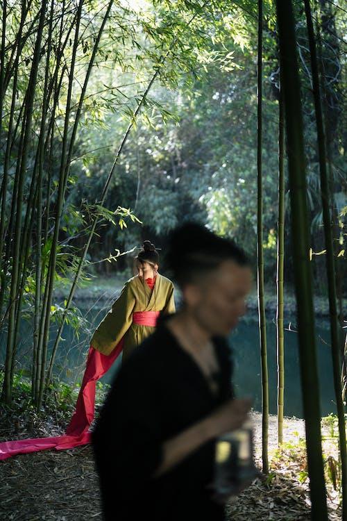 Woman in Green Kimono Standing Near A Pond
