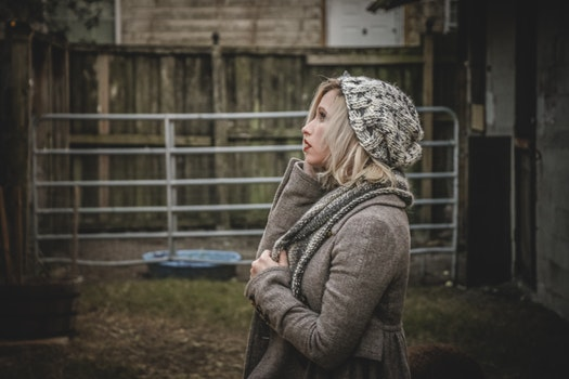 Woman Wearing Gray Hoodie and Knit Cap