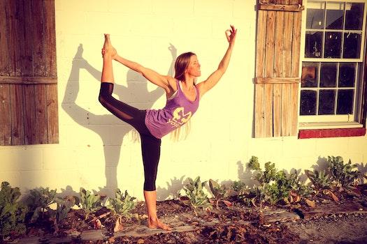 Woman Doing Yoga at Garden