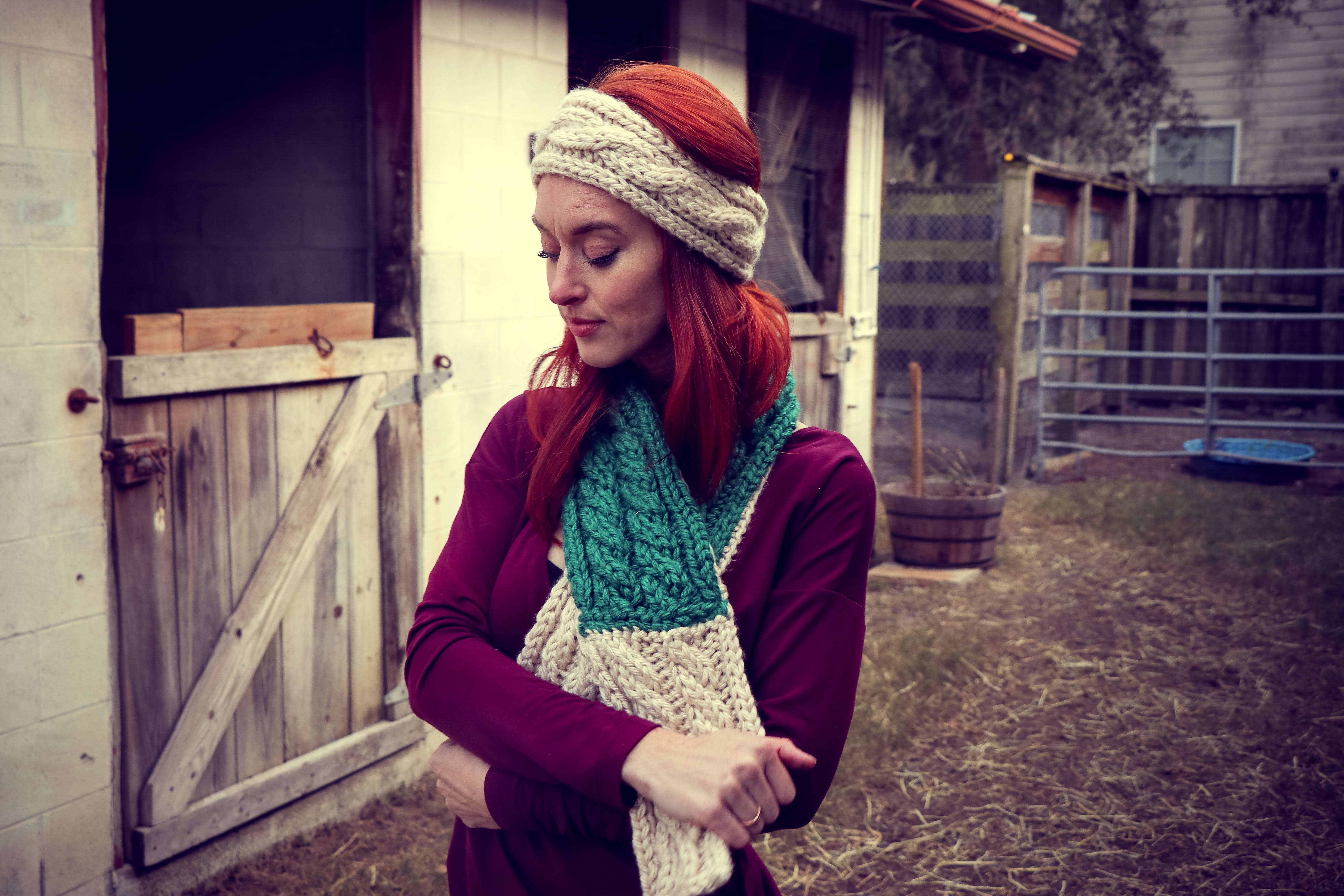 Woman in Purple Sweatshirt Wearing Knitted Beanie and Scarf