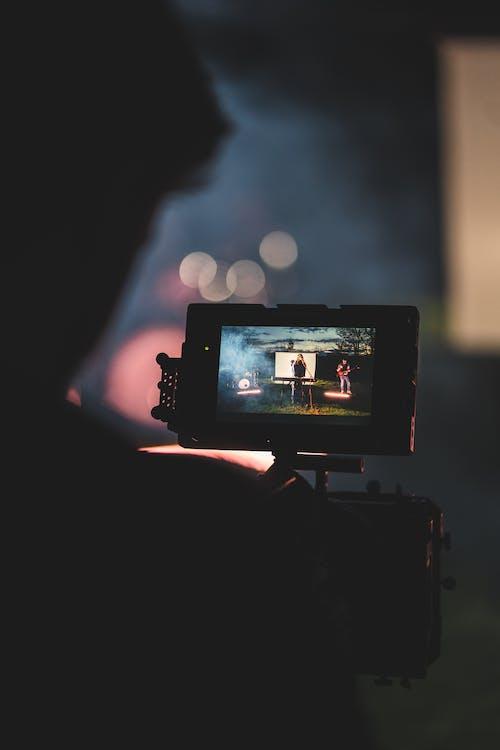 Black Dslr Camera Taking Photo of White Lights