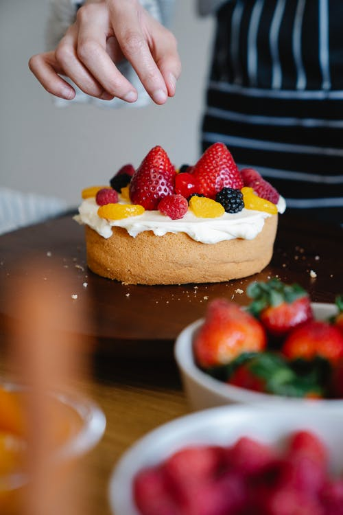 Strawberry Cake on Brown Wooden Table