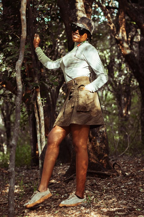 Woman in White Long Sleeve Shirt and Brown Skirt Standing on Forest