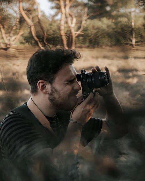 Photographer taking photo of nature