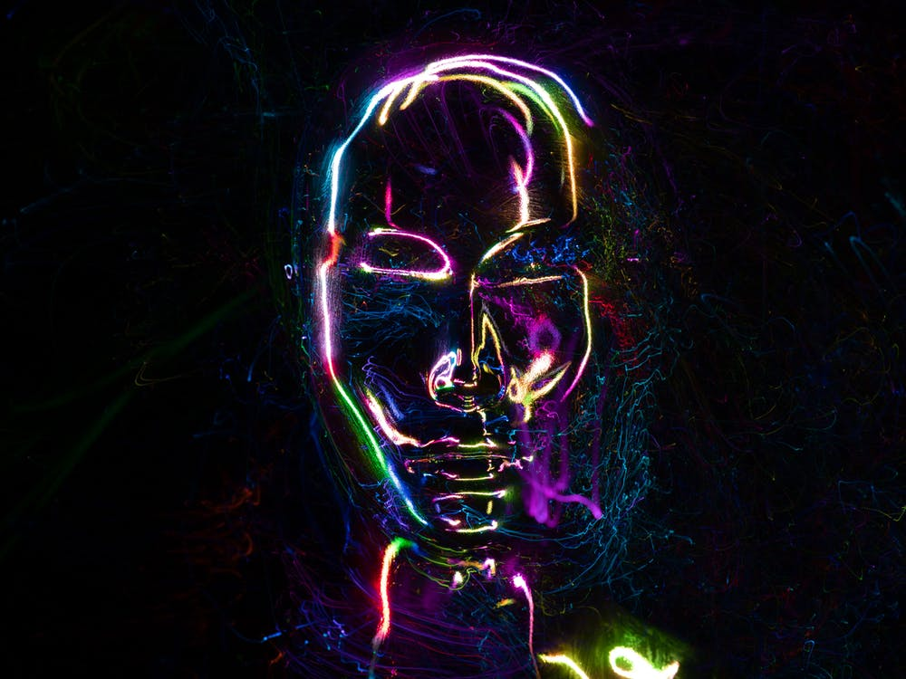 Close-Up Shot of a Colorful Neon Lights in Human Shape
