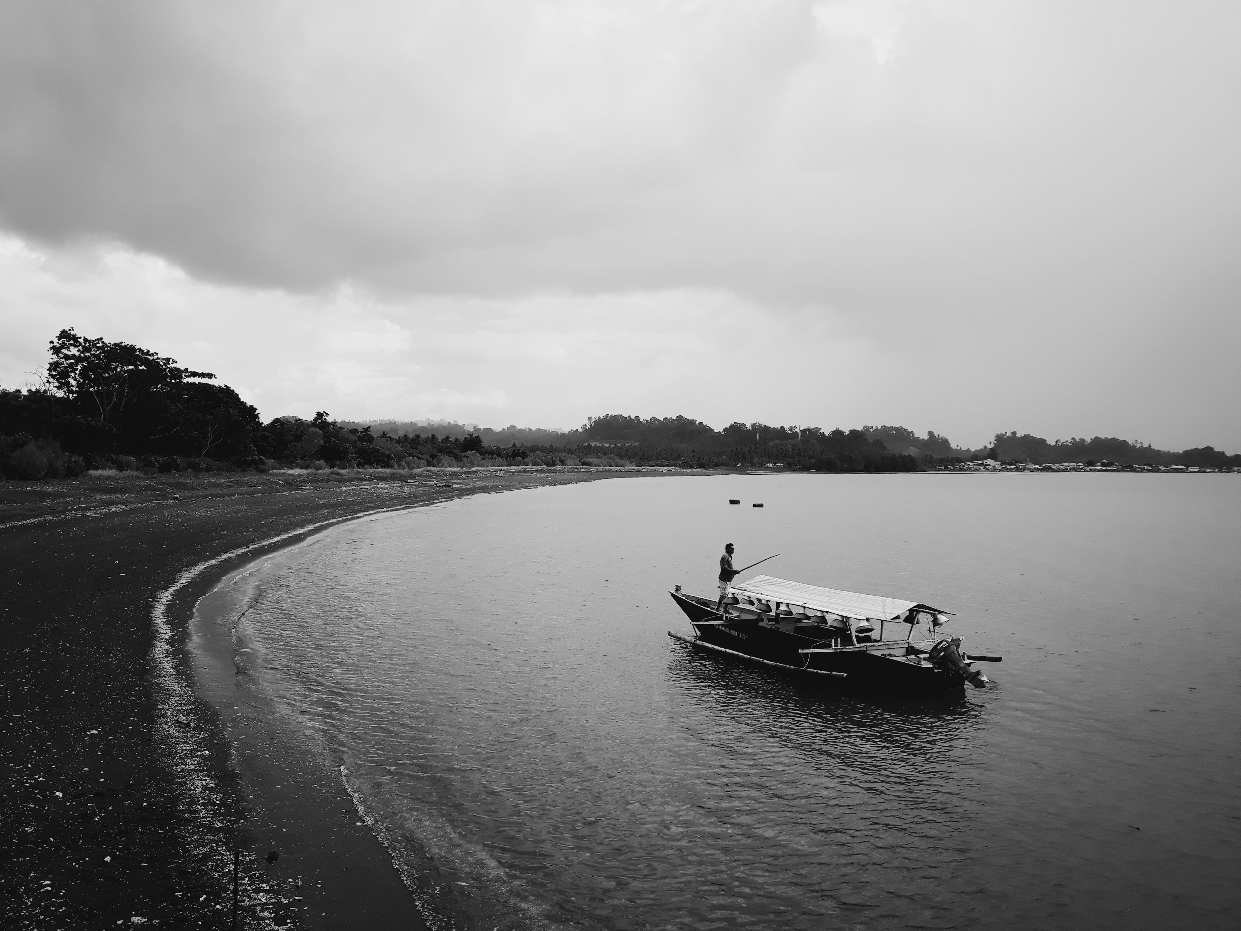 Grayscale Photo of Row Boat