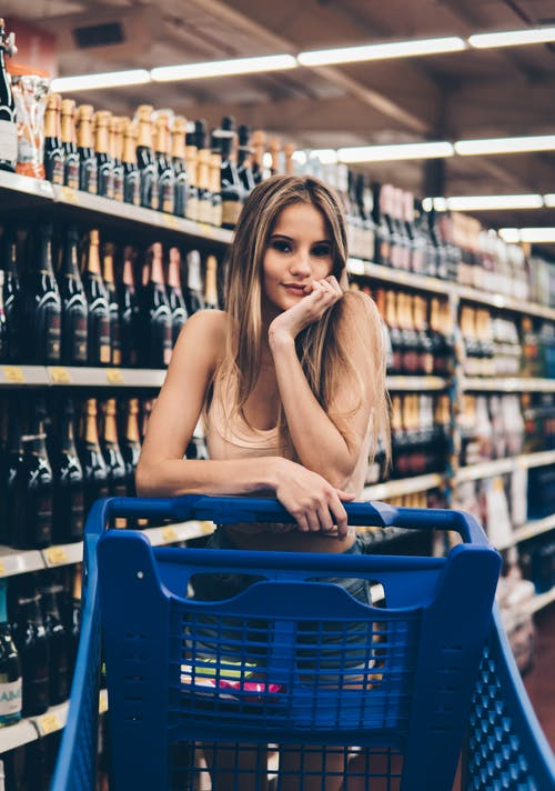 Woman Leaning on a Shopping Cart