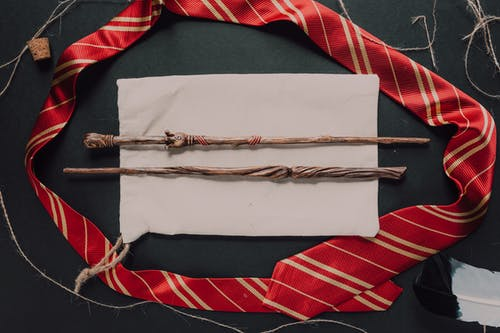 Wooden Stick on Top of White Textile