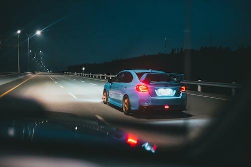 Back View of Subaru Car on Highway