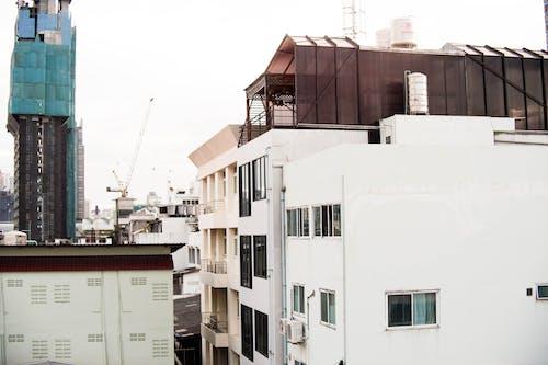akşam, Akşam gökyüzü, apartman binası, bina içeren Ücretsiz stok fotoğraf