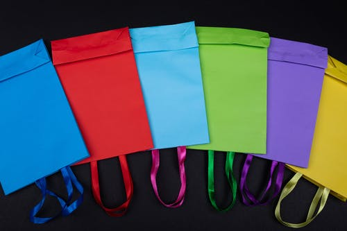 Colorful Paper Bags over Black Surface