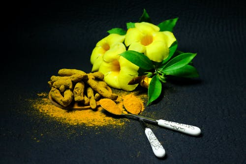 Yellow Flower Besides Root Crops