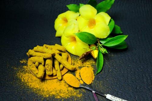 Root Crops Coated with Powder Besides Yellow Bell  Flowers