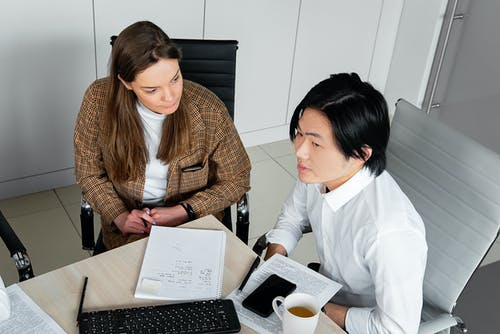 A Man and a Woman Sitting in an Office