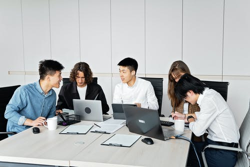 A Group of People Sitting in an Office