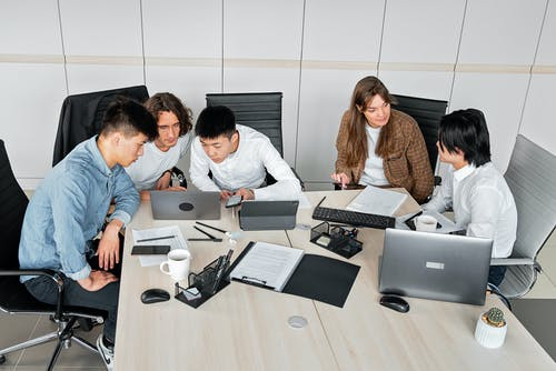 A Group of People Discussing in an Office