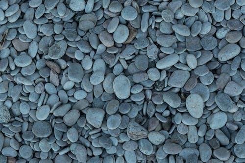 Kostenloses Stock Foto zu grau, hintergrund, kieselsteine, steine