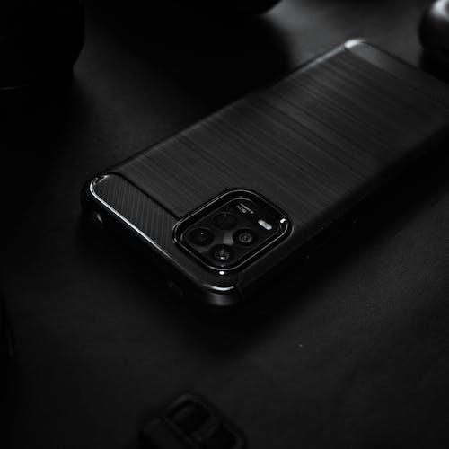 Black Smartphone on Black Table