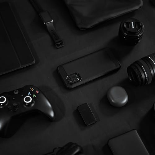 Black Xbox One Game Controller and Black Smartphone Case