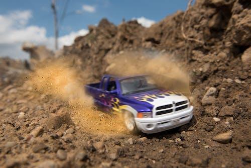 Free stock photo of dirt, dodge ram, mud, peeling out