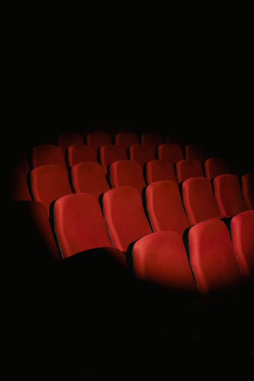 Red Chairs in Dark Room