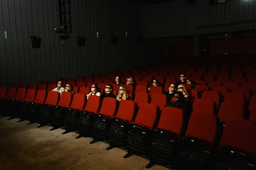 People Sitting on Red Chairs
