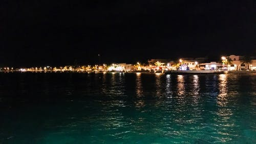 城市的燈光, 晚上, 海 的 免費圖庫相片