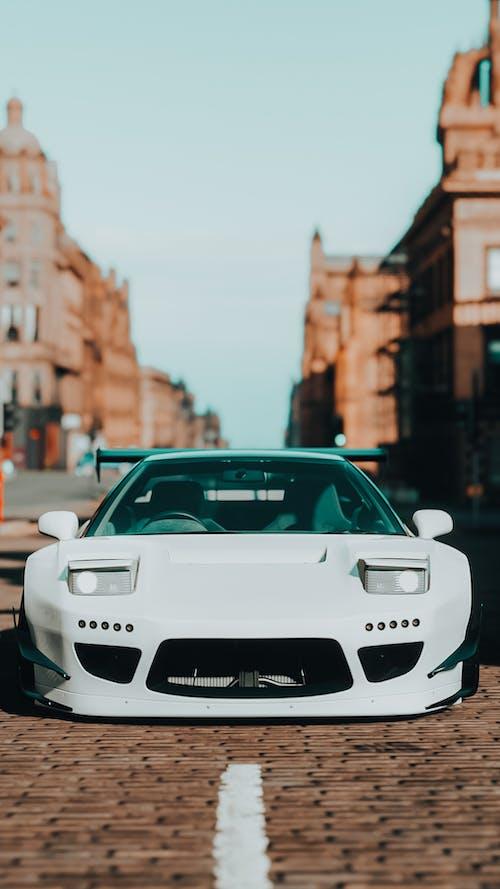 White Porsche 911 Parked on Street