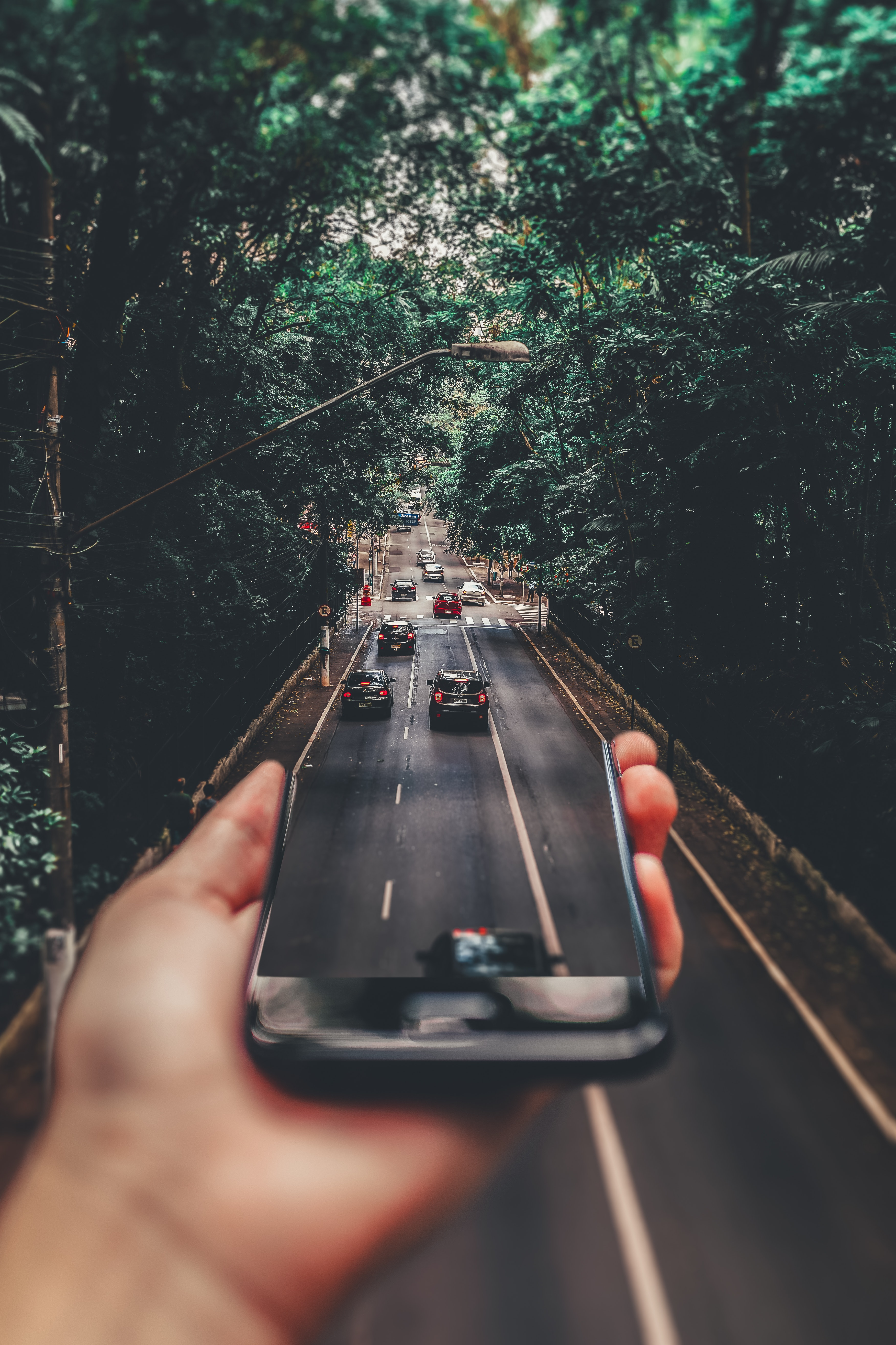 forced perspective photography of cars running on road
