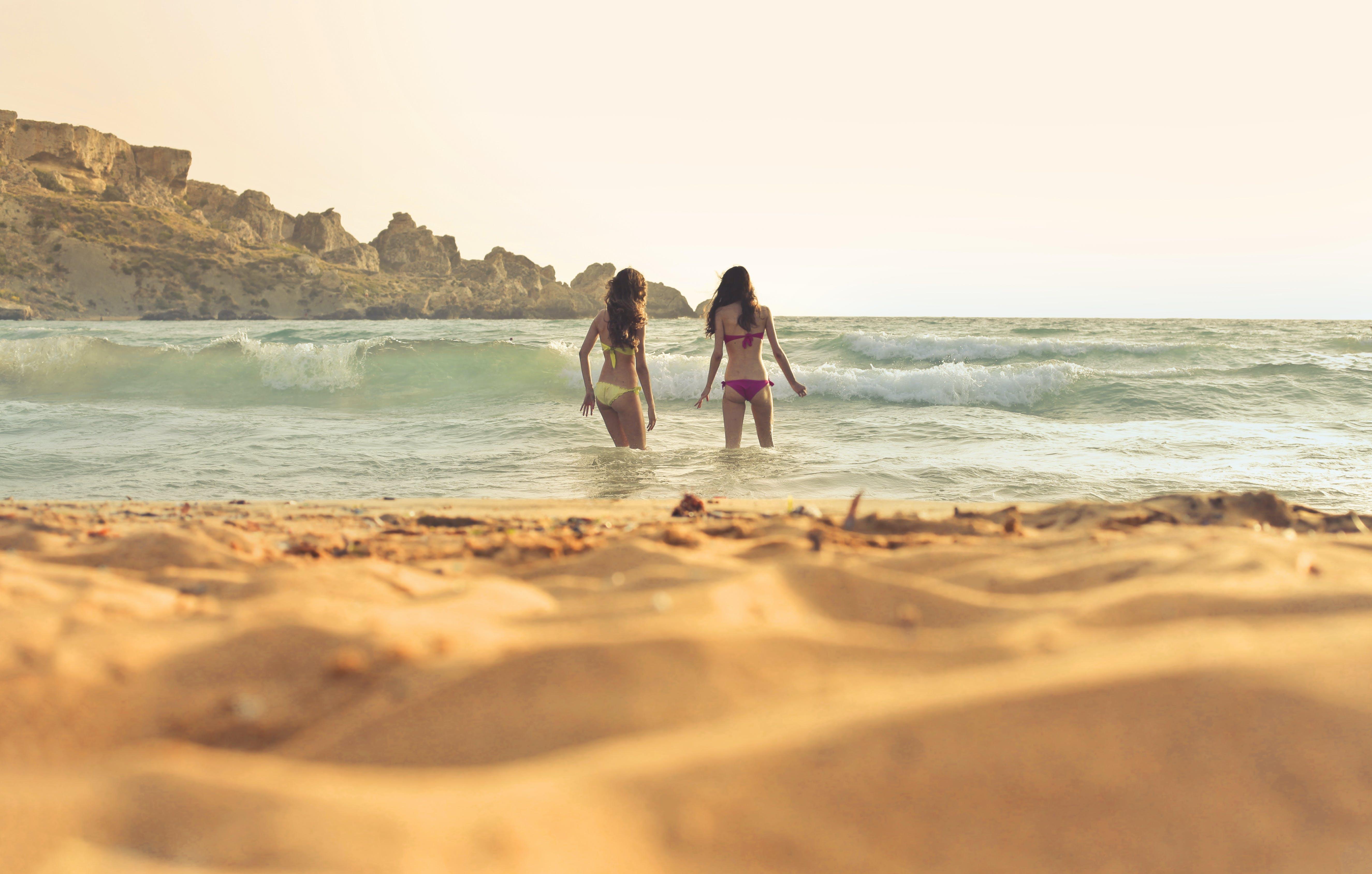 Photo of Women Wearing a Bikini on Beach