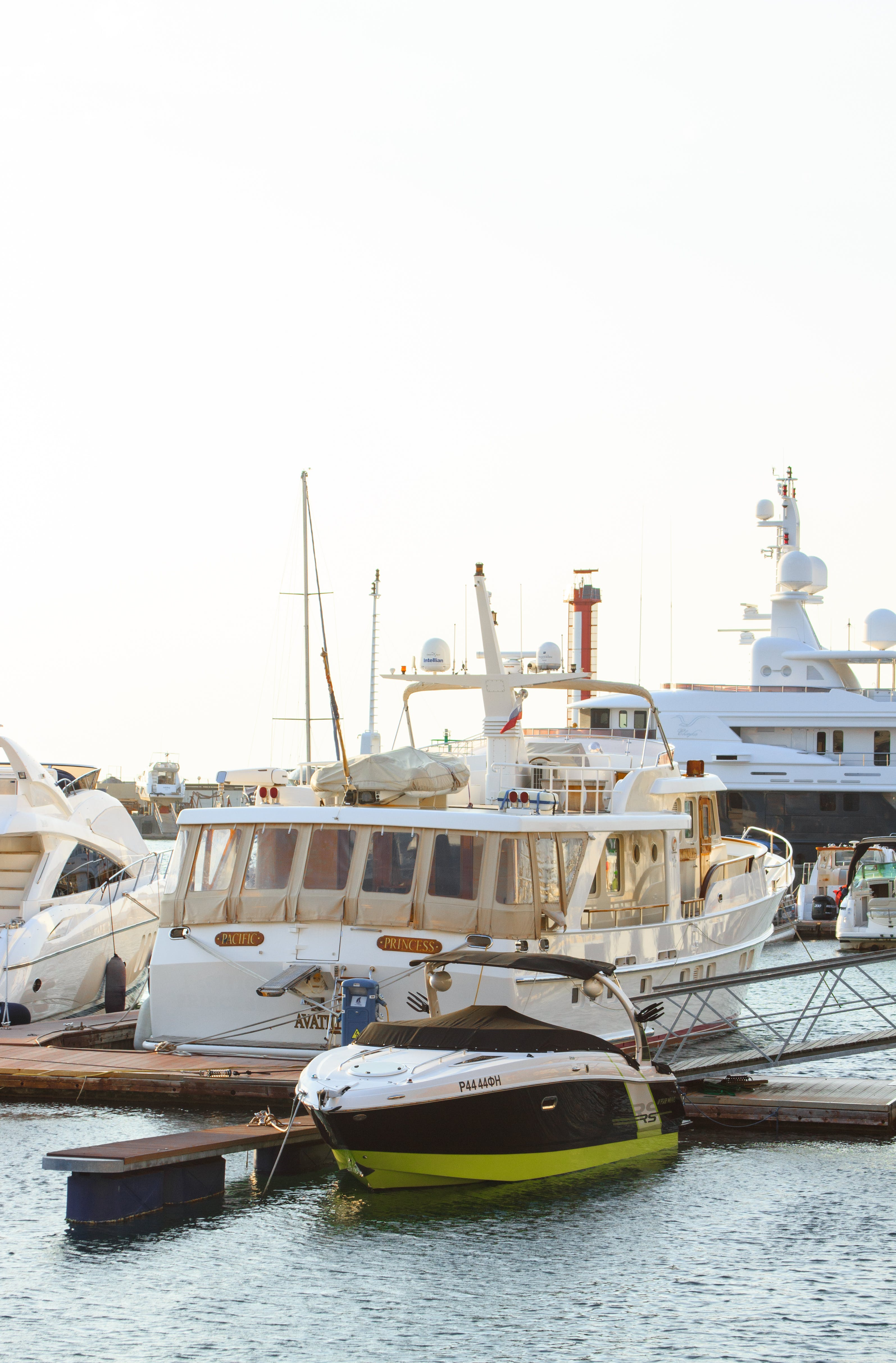 White Yacht Parked on Wooden Dock