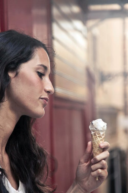 Photography of a Woman Holding Ice Cream