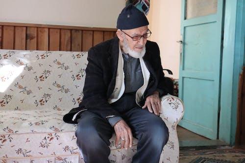 An Elderly Man Sitting on the Sofa