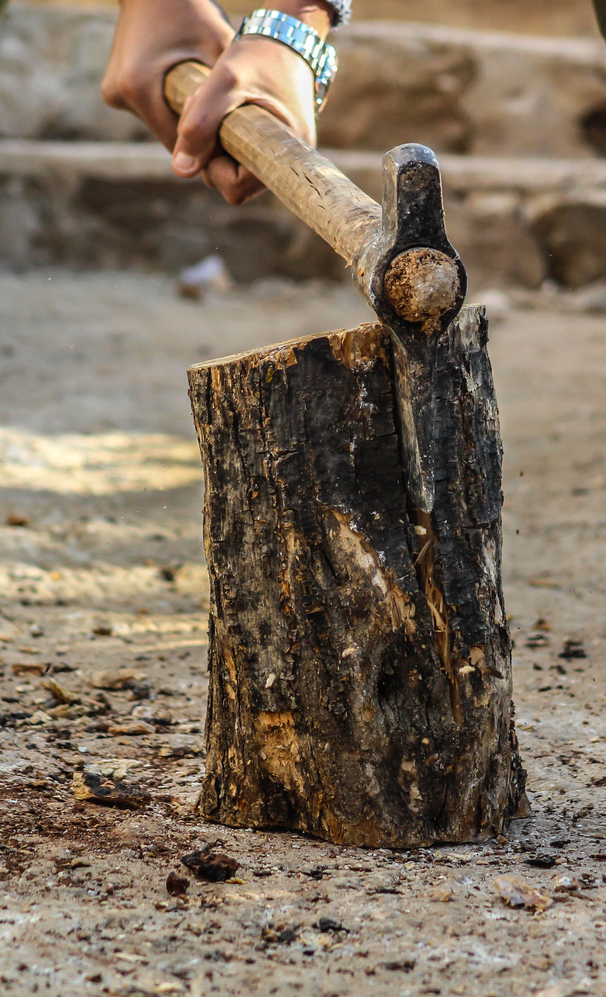 Photography of a Person Chopping Wood