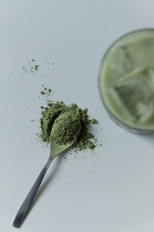 A Teaspoon of Matcha on White Surface
